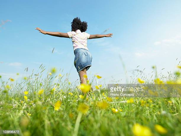 Girl running in grass