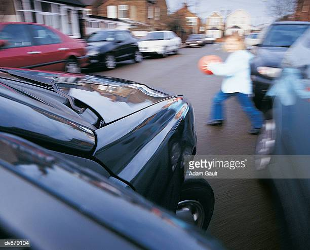 Girl Running Into the Street in Front of a Car