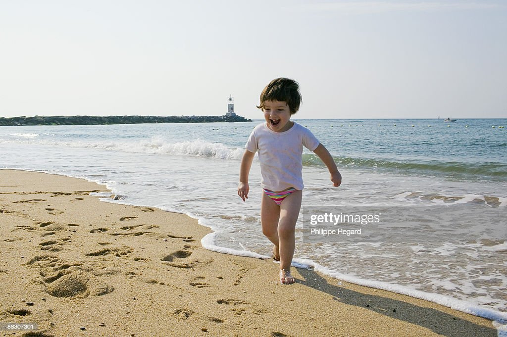 Girl Running On Beach Stock Photo   Getty Images Girl Running On Beach
