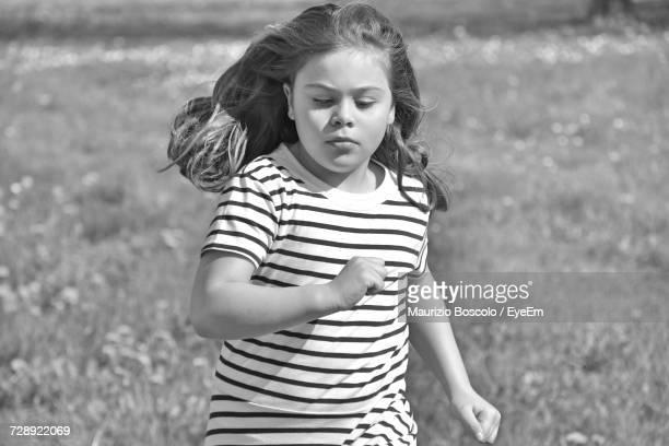 Girl Running On Field