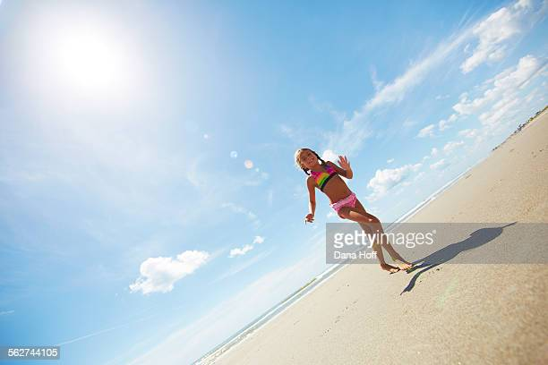 Girl running on Florida beach