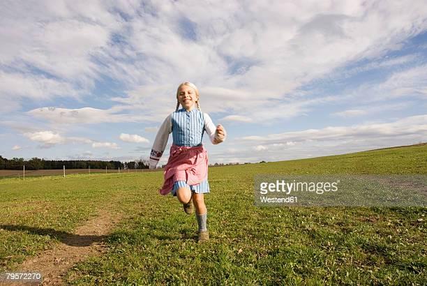 Girl running on meadow