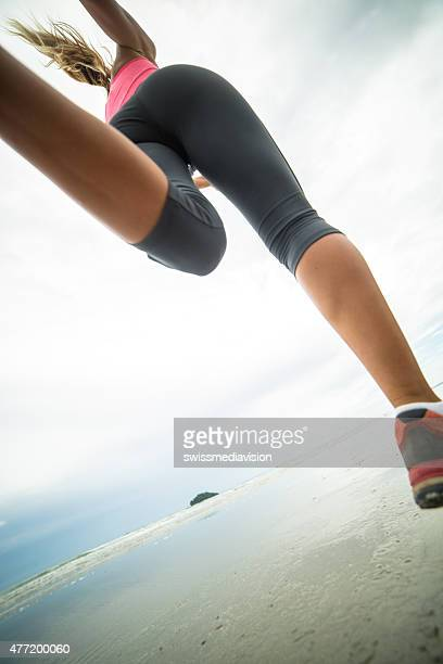 Girl running on the beach-Low angle