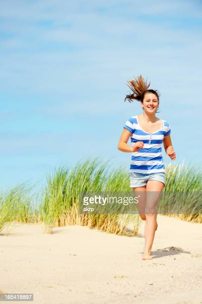 Girl Running over the Dunes
