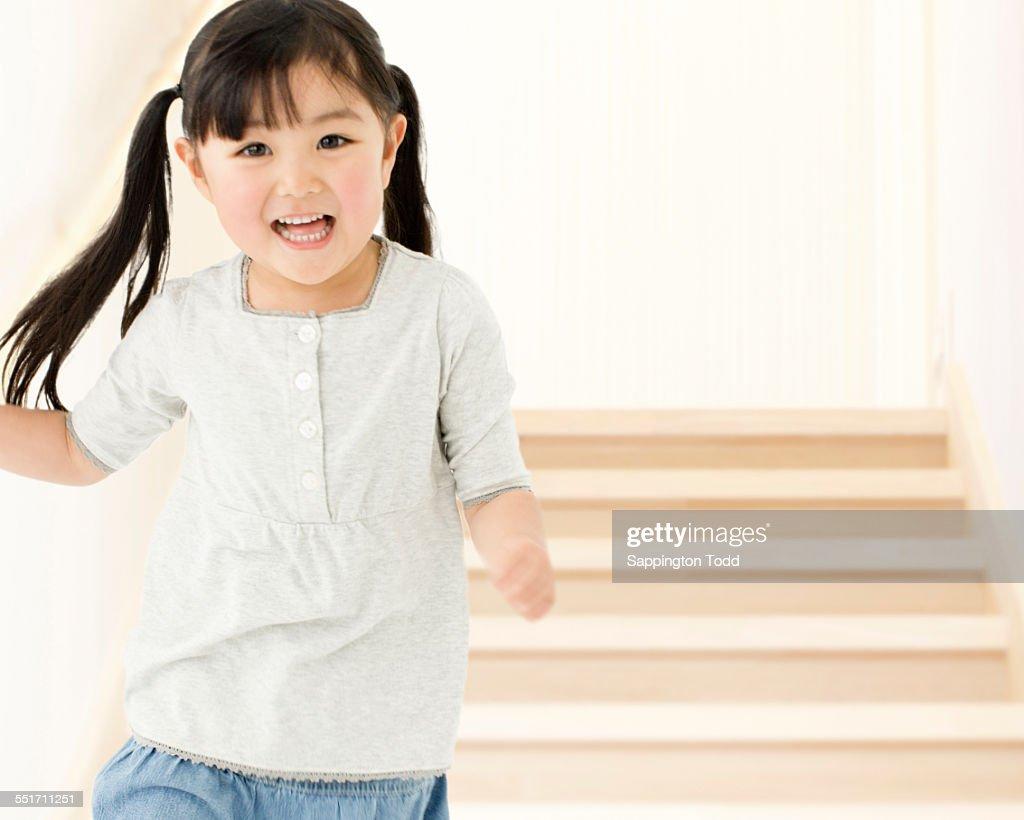 Girl Running Through Stairs : Stock Photo