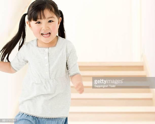 Girl Running Through Stairs