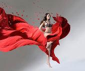 Girl running through the fabric