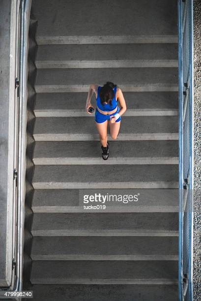 Girl running up the stairs