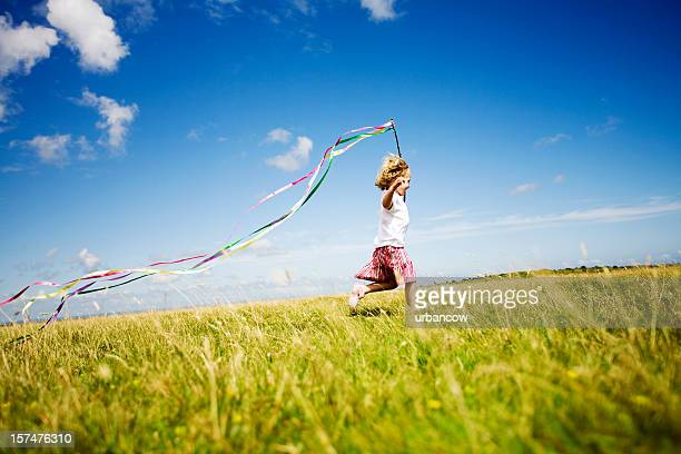 Girl running with streamers