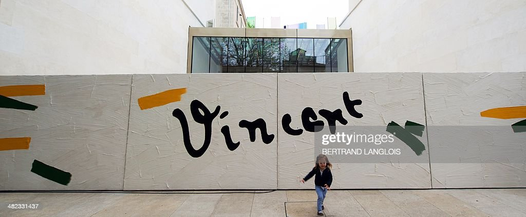 A girl runs in front of the facade of the Fondation Vincent van Gogh Arles on April 3, 2014 in Arles, southern France. Dutch painter Vincent Willem van Gogh (18531890) lived in Arles from February 20 to May 8, 1989. During his stay, he produced over 200 paintings, made over 100 drawings and watercolours, and wrote some 200 letters.