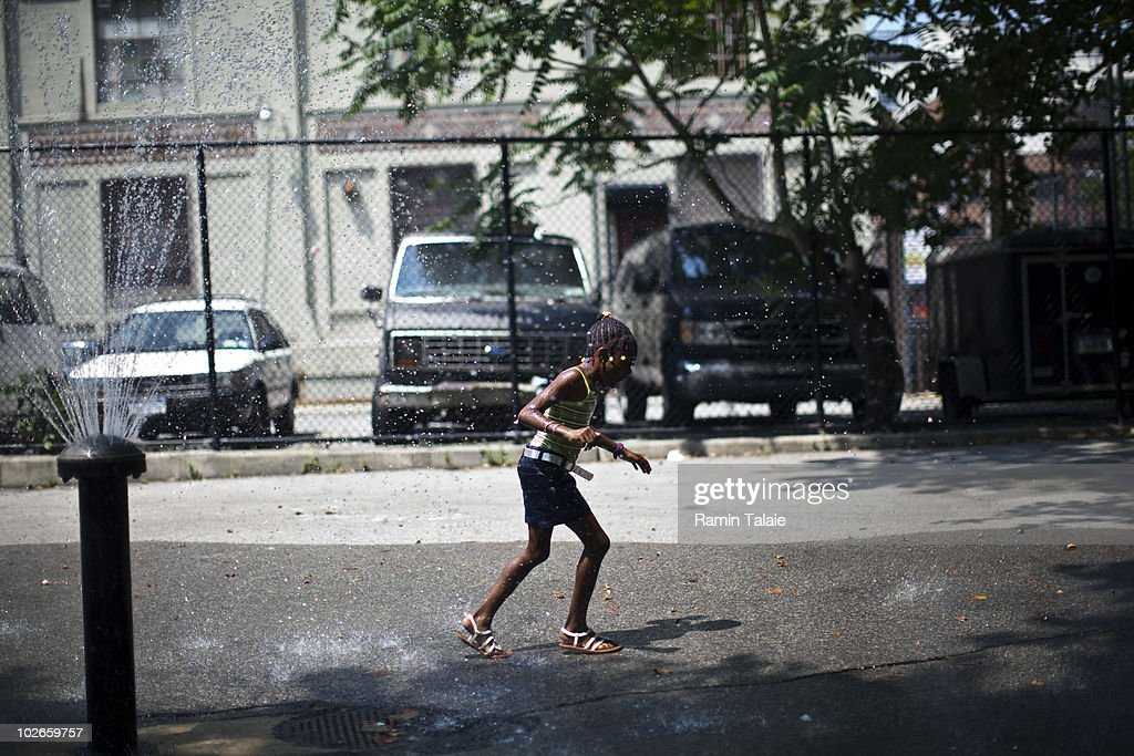 A girl runs through a water fountain to cool off on July 6, 2010 in the Brooklyn borough of New York City. The National Weather Service has issued a heat advisory for parts of the Northeast, mid-Atlantic and parts of Michigan and Kentucky with temperatures in some areas predicted to reach 100 degrees.