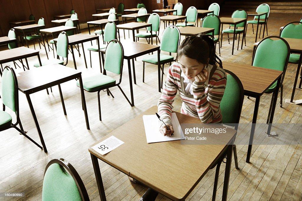 Girl sat alone in exam room : Stock Photo