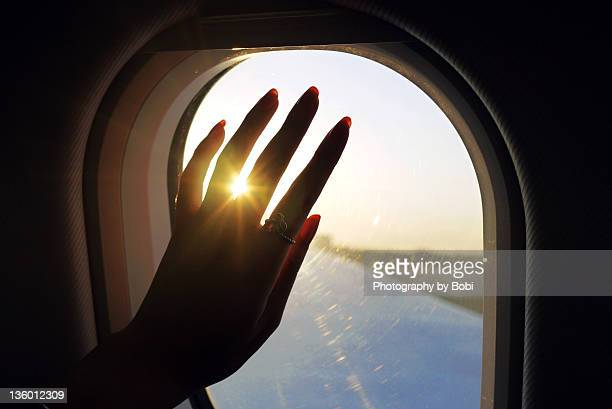 Girl say good bye into cabin beside window