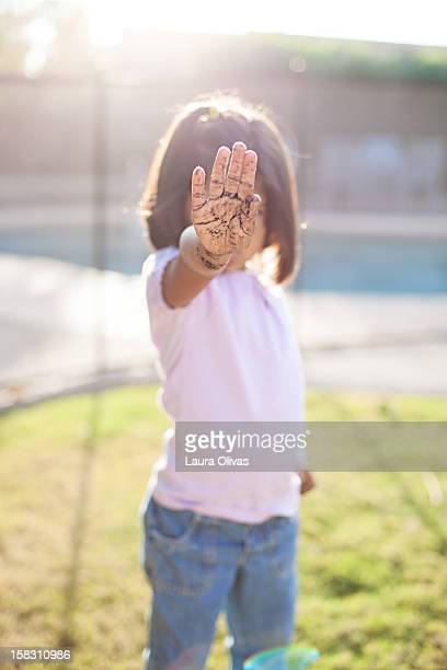 Girl Says Stop With Muddy Hand