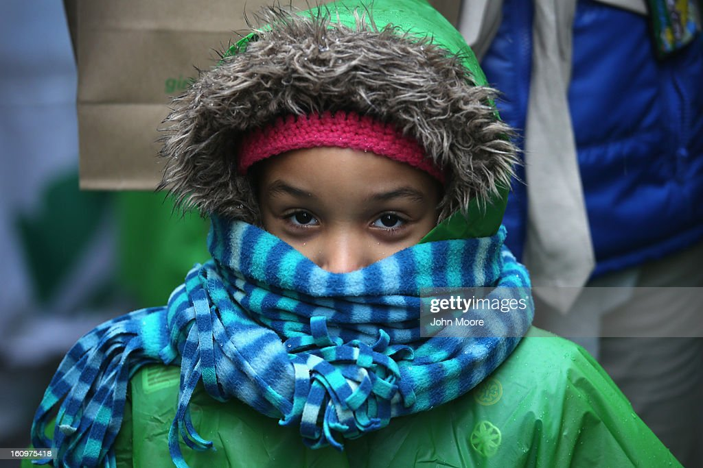 A Girl Scout bundles up while selling cookies as a winter storm moves in on February 8, 2013 in New York City. The scouts did brisk business, setting up shop in locations around Midtown Manhattan on National Girl Scout Cookie Day.