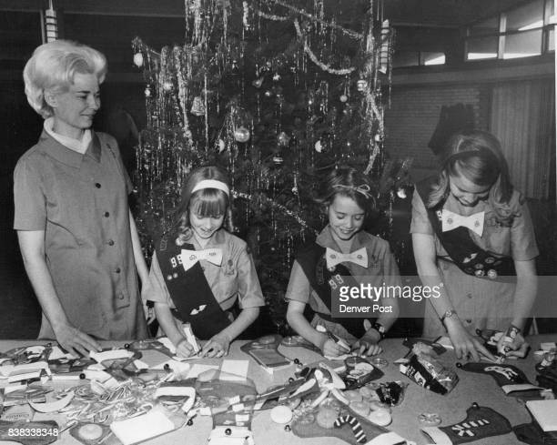 Girl Scouts fill Christmas Stockings for Head Start Children From left are Mrs William Gray coleader 1323 S Eudora St Jean Phillips 4631 E Wyoming...
