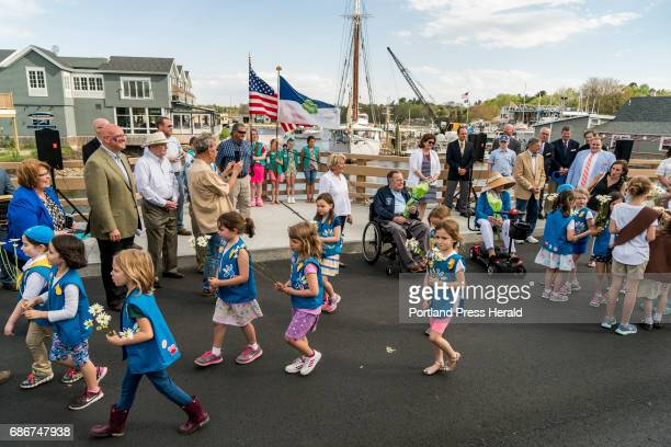 Girl scouts from Kennebunk and Kennebunkport walk across the Mathew J Lanigan bridge after its dedication with former President George HW Bush and...