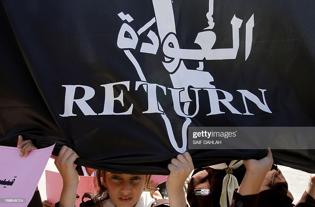 Girl scouts hold up a black flag that reads in Arabic: 'Return', as they commemorate the 1948 creation of the Jewish state known in Arabic as the 'Nakba' during a rally in the West Bank city of Jenin on May 13, 2013. Palestinians and Arab Israelis are preparing to mark Nakba day on May 15 which commemorates the exodus of hundreds of thousands of their kin after the establishment of Israel state.