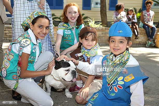 Girl Scouts pose with Rubble the dog as Marisol Deluna New York Celebrates the Grand Opening Of Design Studio And Educational Foundation At La...