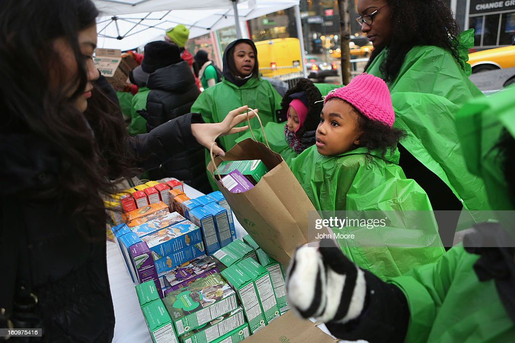 Girl Scouts sell cookies as a winter storm moves in on February 8, 2013 in New York City. The scouts did brisk business, setting up shop in locations around Midtown Manhattan on National Girl Scout Cookie Day.