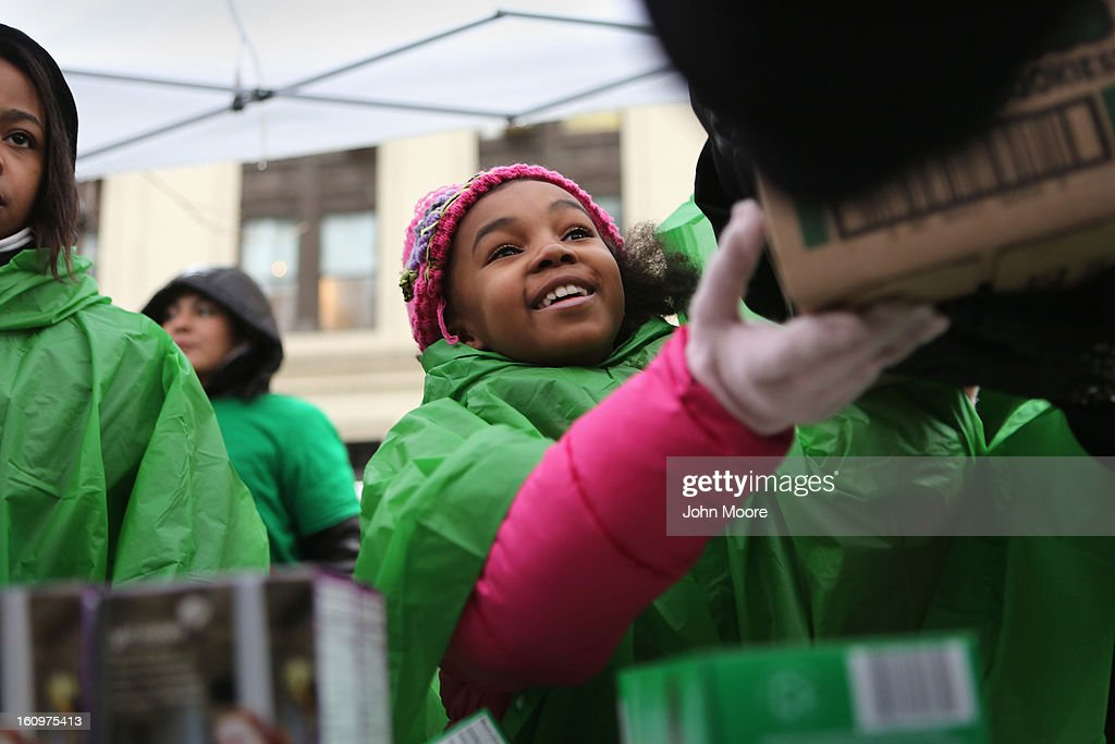 A Girl Scouts sells cookies as a winter storm moves in on February 8, 2013 in New York City. The scouts did brisk business, setting up shop in locations around Midtown Manhattan on National Girl Scout Cookie Day.