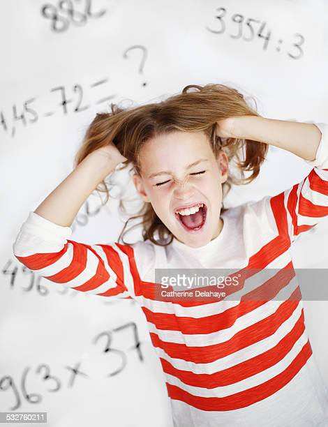 A girl screaming in front of maths operations