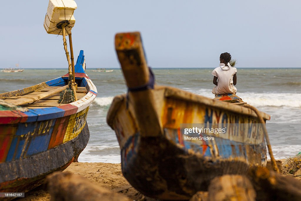 Girl seated on bow of fishing boat
