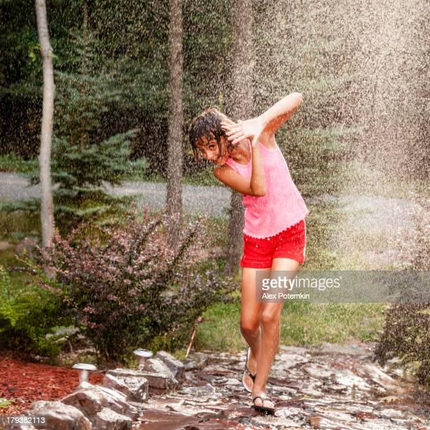 Girl seek shelter under a summer rain