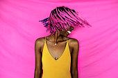 Girl shaking her pink braided hair