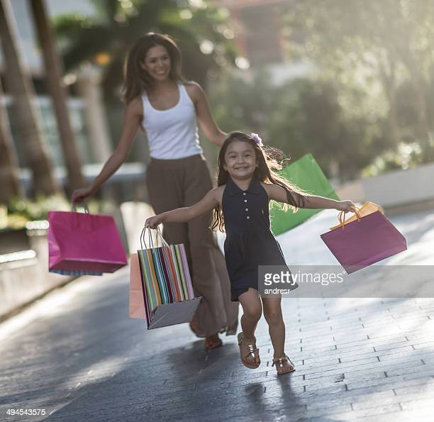 Girl shopping with her mother