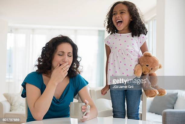 Girl shouting at stressed mother