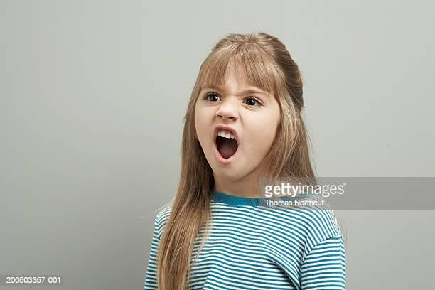 Girl (4-6) shouting, looking away