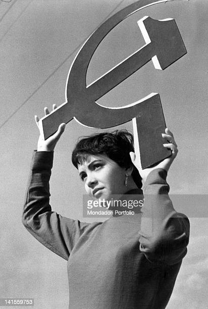 A girl showing hammer and sickle the symbol of the PCI during the campaign for the general election Italy 1953