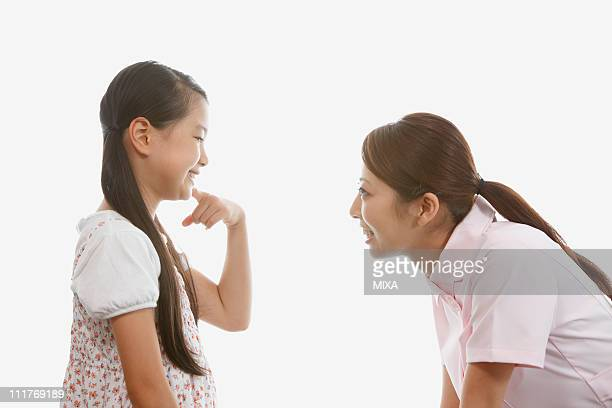 Girl Showing Teeth to Dentist