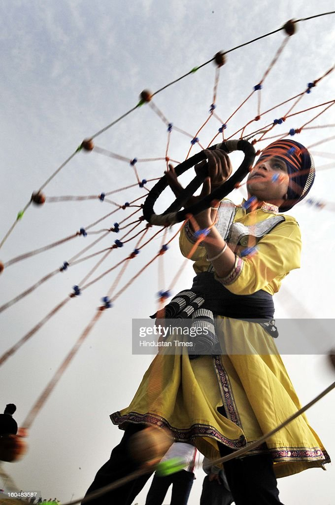 A girl showing the skills during Gatka performance at Kila Raipur on the first day of 77th Rural sports festival at Kila Raipur on February 1, 2013 near Ludhiana, India. The Kila Raipur Rural Olympics is a rural sports festival that's grown over six decades, to become a sports bonanza that attracts competitors from around the globe. Held for three days during February each year, over 4,000 sports men and woman participate in the festival. They're watched by around 1 million spectators.
