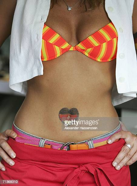 A girl shows her belly button at the FIFA World Cup 2006 Semi Final match between Germany and Italy at the Fan Fest outdoor viewing area at the...