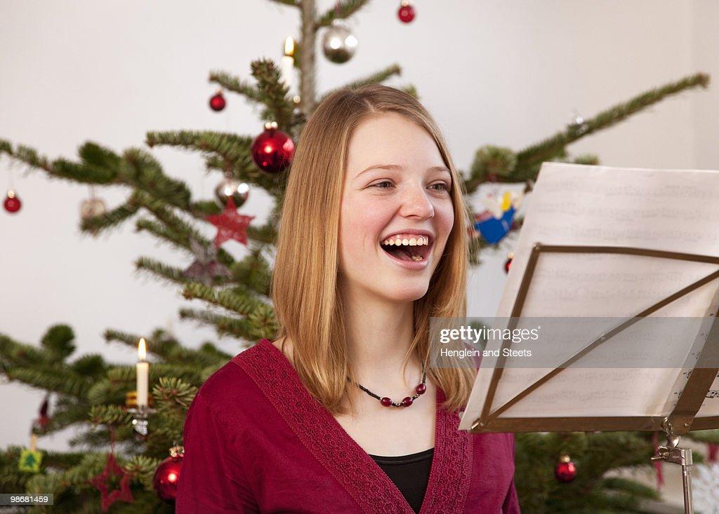 girl singing christmas carols
