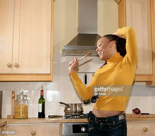 Girl singing in kitchen