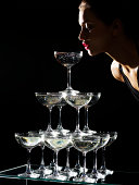 Girl sipping from champagne fountain