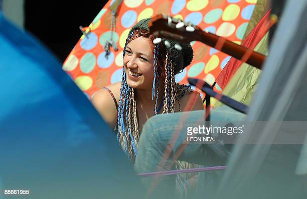 A girl sits among the tents on the first day of the annual Glastonbury festival near Glastonbury Somerset on June 24 2009 Veteran rockers Bruce...