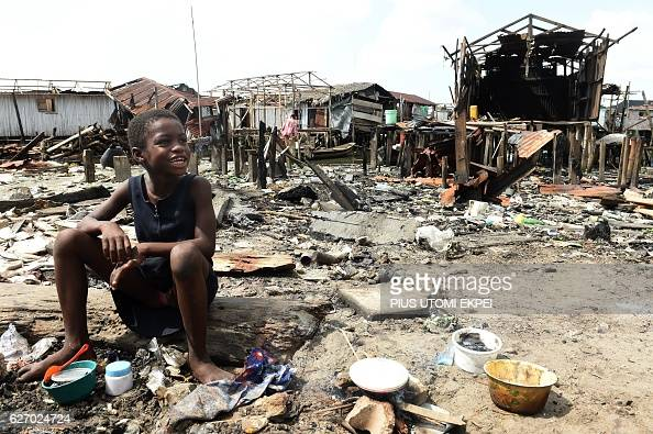 A girl sits at the scene of the family makeshift home demolished by the authorities at Otodo Gbame waterfront fishing communities in Lagos on...