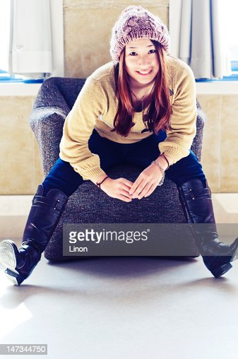 Girl sitting and smiling : Stock Photo