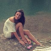Girl sitting at lake