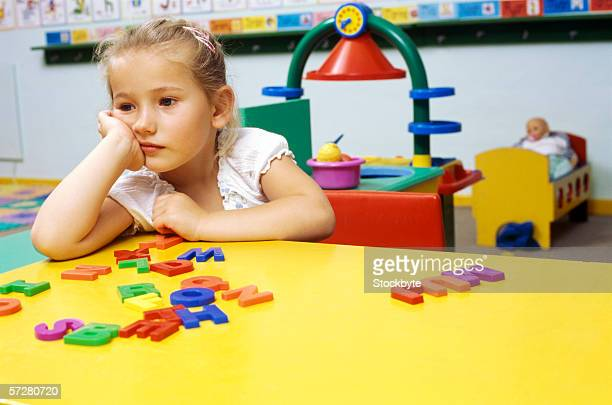 Girl sitting at the table in classroom
