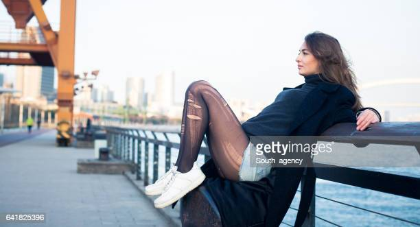Girl sitting by the river