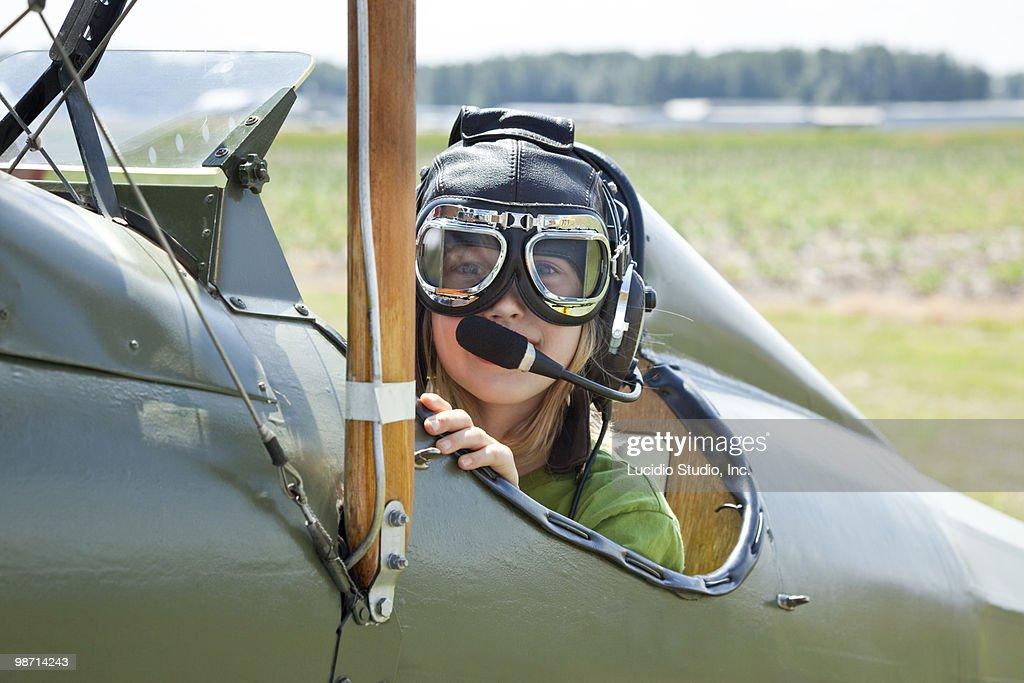 Girl sitting in an open cockpit biplane