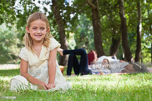 Girl sitting in grass at park