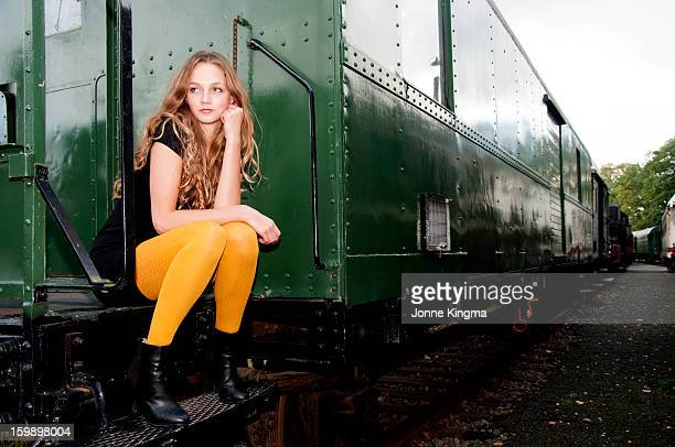 Girl sitting on an old train