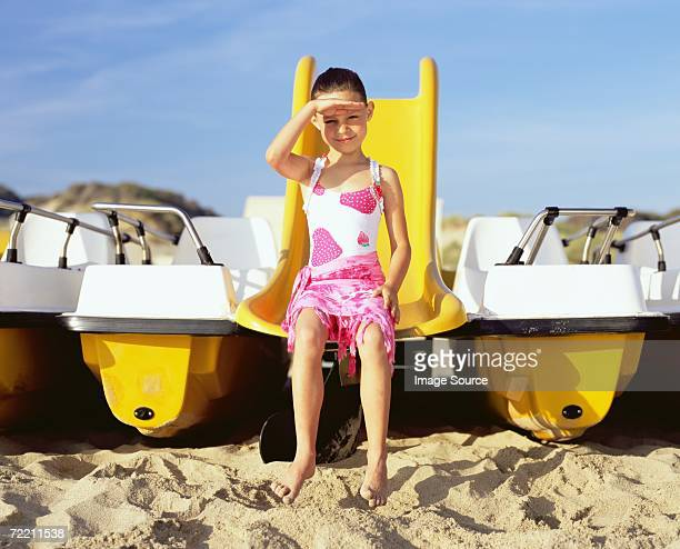 Girl sitting on boat slide