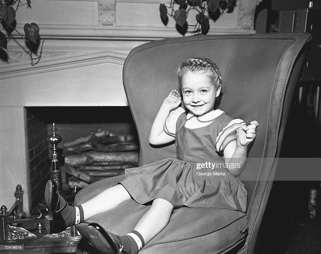 Black child sitting in chair - Girl 6 7 Sitting On Chair At Fireplace B W Portrait